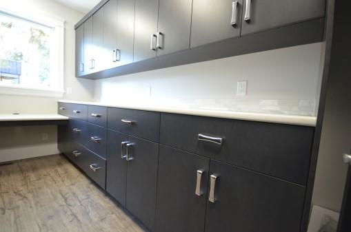 Laundry Room Photography with dark cabinets.