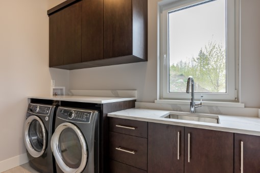 Laundry Room Photography with white cabinets.